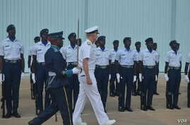 The U.S. Navy's James Foggo, in Ghana to participate in a conference on international maritime defense, inspects Navy personnel. (Stacey Knott for VOA)