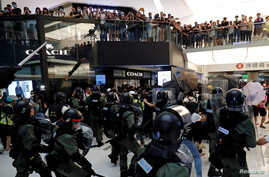 Riot police try to disperse protesters inside a mall in Sha Tin District in Hong Kong, July 14, 2019.