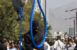 An Iranian policeman prepares to execute a death sentence in Tehran, Iran, Aug. 2, 2007.