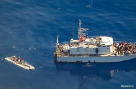 An aerial view shows a Libyan coast guard ship with migrants on deck, in a search and rescue zone off Libya's coast, May 11, 2019, as seen from Germany's Sea-Watch humanitarian organization's Moonbird aircraft.