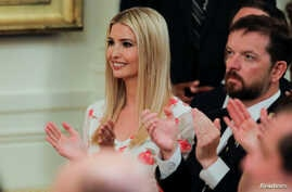 White House Senior Advisor Ivanka Trump applauds along with White House Director of the Domestic Policy Council Joe Grogan at an event held by President Donald Trump to tout his administration's environmental policies at the White House, July 8, 2019.