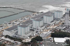 FILE - An aerial view shows Tokyo Electric Power Co.'s Fukushima Daini nuclear power plant in Naraha town, Fukushima prefecture, Japan, in this photo taken by Kyodo, Feb. 26, 2012.