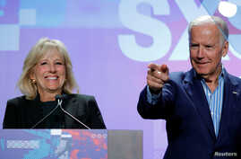 Jill Biden (L) introduces her husband, former U.S. Vice-President Joe Biden, to speak about the Biden Cancer Initiative at the South by Southwest (SXSW) Music Film Interactive Festival 2017 in Austin, Texas, March 12, 2017.