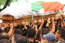 People carry the coffin of Rami Salman, one of two aides of Refugee Affairs Minister Saleh al-Gharib, who was killed in an incident that Gharib called an assassination attempt, during his funeral in Ramlieh, Lebanon, July 5, 2019.