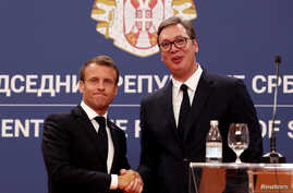 French President Emmanuel Macron and Serbian President Aleksandar Vucic shake hands after a joint news conference at the Serbia Palace building in Belgrade, Serbia, July 15, 2019.