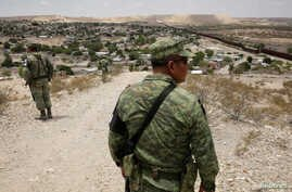 Members of the Mexican National Guard patrol the border with the United States, as seen from Anapra neighborhood, on the outskirts of Ciudad Juarez, Mexico, July 24, 2019.