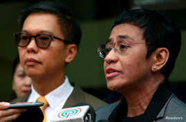 Rappler CEO and Executive Editor Maria Ressa speaks to the media after pleading 'not guilty' to tax evasion charges at the Court of Tax Appeals in Quezon City, Philippines, April 3, 2019.