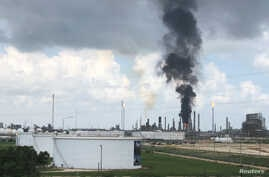 Smoke rises from a fire at Exxon Mobil's refining and chemical plant complex in Baytown, near Houston, Texas, July 31, 2019.