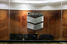 The logo of Chevron is seen at the company's office in Caracas, Venezuela, April 25, 2018.