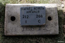 The name of Rafael Acosta Arevalo, a navy captain who died while in detention according to his family, is seen at his grave after a burial at a cemetery in Caracas, Venezuela, July 10, 2019.