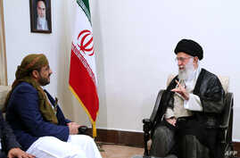 A handout picture provided by the office of Iran's Supreme Leader Ayatollah Ali Khamenei shows him meeting with Mohammed Abdul-Salam, left, spokesman for Yemen's Huthi rebels, during their meeting at Khamenei's residence in Tehran, Aug. 13, 2019.