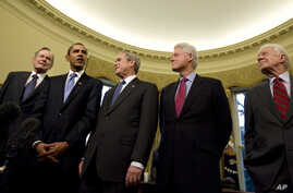 President George W. Bush hosts President-elect Barack Obama, and former presidents, from left, George H.W. Bush, Bill Clinton and Jimmy Carter, Jan. 7, 2009, in the Oval Office of the White House in Washington.