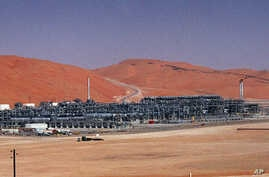 FILE - An industrial plant strips natural gas from freshly pumped crude oil is seen at Saudi Aramco's Shaybah oil field at Shaybah in Saudi Arabia's Rub al-Khali desert.