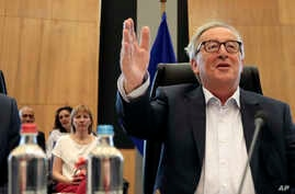 FILE - European Commission President Jean-Claude Juncker chairs a meeting of the college of commissioners at EU headquarters in Brussels, July 24, 2019.