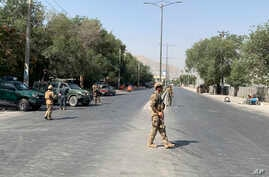 FILE - Afghan police arrive at the site of an explosion in Kabul, Afghanistan Thursday, July 25, 2019.