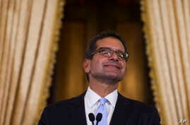 Pedro Pierluisi, sworn in as Puerto Rico's governor, smiles during a press conference in San Juan, Puerto Rico, Aug. 2, 2019.