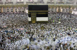 Muslim pilgrims circumambulate around the Kaaba, the cubic building at the Grand Mosque, ahead of the Hajj pilgrimage in the Muslim holy city of Mecca, Saudi Arabia, Wednesday, Aug. 7, 2019.