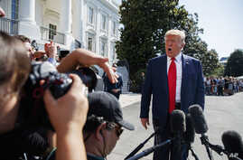 President Donald Trump talks to reporters on the South Lawn of the White House, Aug. 9, 2019, in Washington, as he prepares to leave Washington for his annual August holiday at his New Jersey golf club.