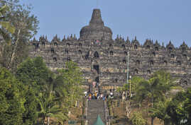Tourists visit Borobudur Temple in Magelang, Central Java, Indonesia, Aug. 12, 2019.