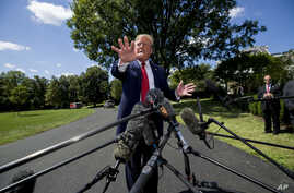 President Donald Trump speaks with reporters before departing on Marine One on the South Lawn of the White House, Aug. 21, 2019, in Washington.