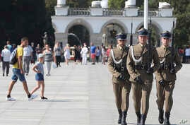Polish soldiers take part in a changing of the guard at the Tomb of the Unknown Soldier at Pilsudski Square in Warsaw, Poland,  Aug. 27, 2019. The square will be the site of commemorations Sunday marking the 80th anniversary of the start of World War II.