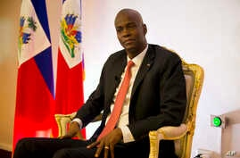 Haiti's President Jovenel Moise pauses during an interview in his office in Port-au-Prince, Haiti, Wednesday, Aug. 28, 2019.