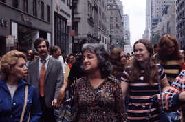 National Organization for Women co-founder Betty Friedan, center, participates in the Women's Strike for Equality in New York