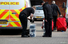 FILE - Inspectors from the Organization for the Prohibition of Chemical Weapons (OPCW) arrive to begin work at the scene of a nerve agent attack on former Russian agent Sergei Skripal, Salisbury, Britain, March 21, 2018.