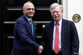 Britain's Chancellor of the Exchequer Sajid Javid shakes hands with U.S. National Security Adviser John Bolton at Downing Street in London, Britain, August 13, 2019.