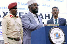 Ahmed Mohamed Madobe, the president of the Jubbaland region, takes the oath of office after winning their presidential election, in the southern port town of Kismayo, Somalia, Aug. 22, 2019.