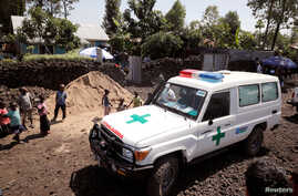 FILE - An ambulance waits next to a health clinic to transport a suspected Ebola patient, in Goma in the Democratic Republic of Congo, Aug. 5, 2019.