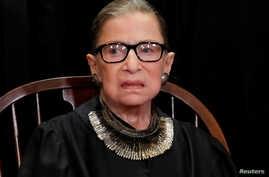 FILE - U.S. Supreme Court Associate Justice Ruth Bader Ginsburg is seen during a group portrait session for the new full court a