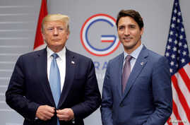 U.S. President Donald Trump and Canada's Prime Minister Justin Trudeau hold a bilateral meeting during the G7 summit in Biarritz,