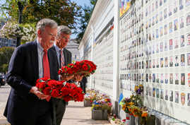 U.S. National Security Adviser John Bolton and U.S. Embassy Charge d'Affairs William Taylor attend a wreath-laying ceremony at the memorial for soldiers killed in a recent conflict in eastern Ukraine, in Kyiv, Ukraine, Aug. 27, 2019.
