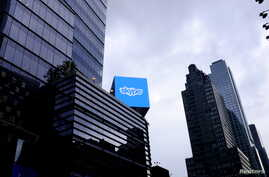 FILE - An advertisement for Skype is seen over 42nd Street in Manhattan, New York.