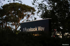 FILE - A Facebook address sign is seen at Facebook headquarters in Menlo Park, California.