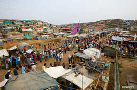 FILE - Rohingya refugees gather at a market inside a refugee camp in Cox's Bazar, Bangladesh, March 7, 2019.