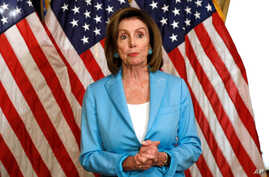 U.S. House Speaker Nancy Pelosi  reacts after signing  the Bipartisan Budget Act of 2019 in Washington, Aug. 1, 2019.