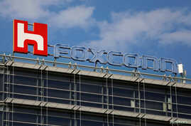 FILE - The logo of Foxconn, the trading name of Hon Hai Precision Industry, is seen on top of the company's building in Taipei, Taiwan.