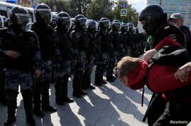 FILE - Law enforcement officers detain a participant in a rally in Moscow, Russia, Aug. 3, 2019.
