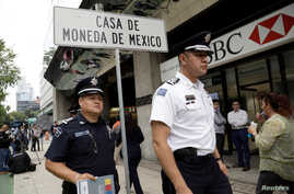 Police officers are seen during a security operation after armed robbers stole gold coins worth more than $2 million, outside Casa de Moneda in Mexico City, Mexico, Aug. 6, 2019.