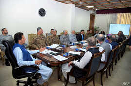 In this handout picture released by Prime Minister Office (PMO) August 7, 2019, Pakistan's Prime Minister Imran Khan (L) chairs a National Security Committee meeting in Islamabad.