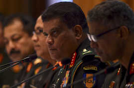 Sri Lanka's new army chief Lieutenant General Shavendra Silva (2R) looks on during a press conference in Colombo, Aug. 26, 2019.
