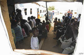 Refugees from South Sudan wait to receive treatment at the Bidibidi health center in the Northern District of Yumbe, Uganda, April 14, 2017.