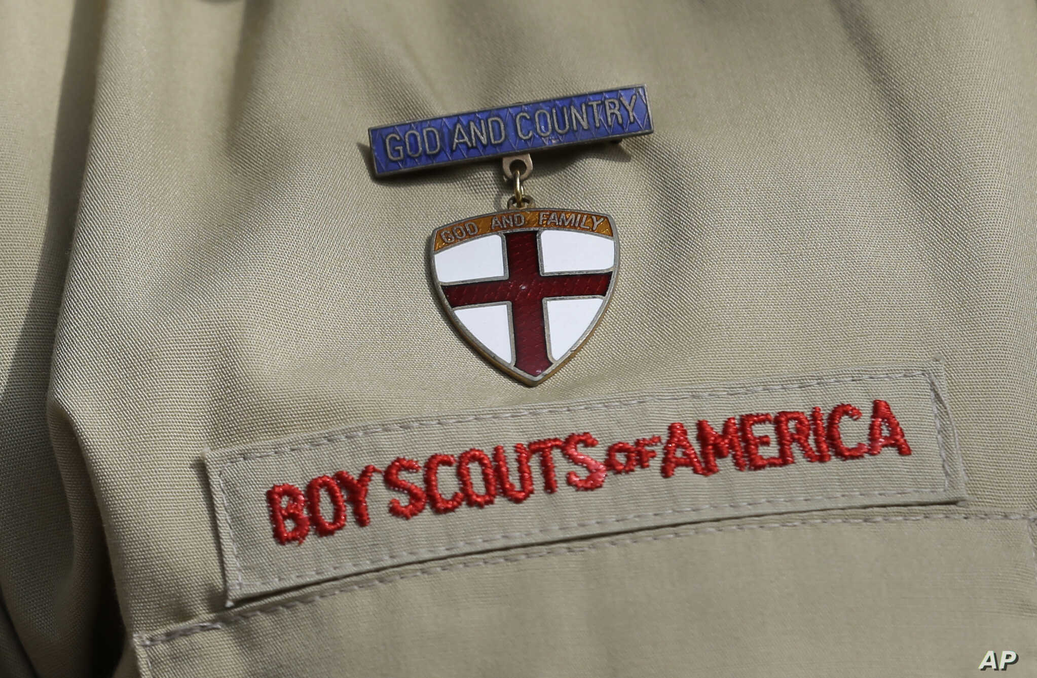 A photo shows a close-up detail of a Boy Scout uniform worn by a scout during a news conference at the Boy Scouts of America headquarters in Irving, Texas, Feb. 4, 2013.