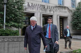 Greg Craig, former White House counsel to former President Barack Obama, left, leaves federal court in Washington, April 12, 2019.
