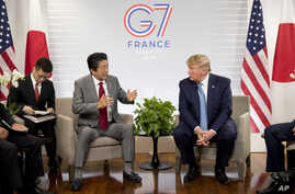 U.S President Donald Trump, right, and Japanese Prime Minister Shinzo Abe attend a bilateral meeting at the G-7 summit in Biarritz, France, Aug. 25, 2019.