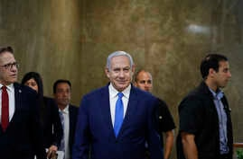 Israel's Prime Minister Benjamin Netanyahu arrives for the weekly cabinet meeting in Jerusalem, July 14, 2019.