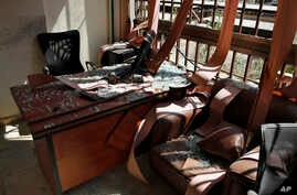Damage is seen inside the media office of the Lebanese Hezbollah group in a southern suburb of Beirut, Aug. 25, 2019.