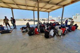 Rescued migrants rest near the city of Khoms, around 120 kilometers (75 miles) east of Tripoli, Libya, Aug. 27, 2019.